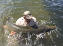 Capt. Andy Jones gets up close and personal with a big alligator gar in Lake Pontchartrain on Friday. Jones said the gar measured 6 feet, 9 inches, and weighed between 160 and 180 pounds.