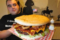 Dale Keys, from Penn, Wolverhampton, with the monster burger at Smokeys in Walsall