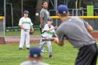 Zander Clark of West Fairlee, VT practices pitching with players from the Vermont Lake Monsters on Centennial Field in Burlington, VT on Friday, Aug. 14, 2015. (Oliver Parini photograph)